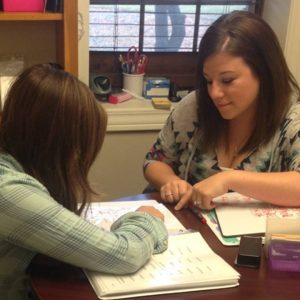 Lisa Mietz reading with a student